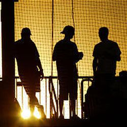 Fans watch final baseball game at Ogden's Lindquist Field as the suns sets during Pioneer League playoff action on Monday night.