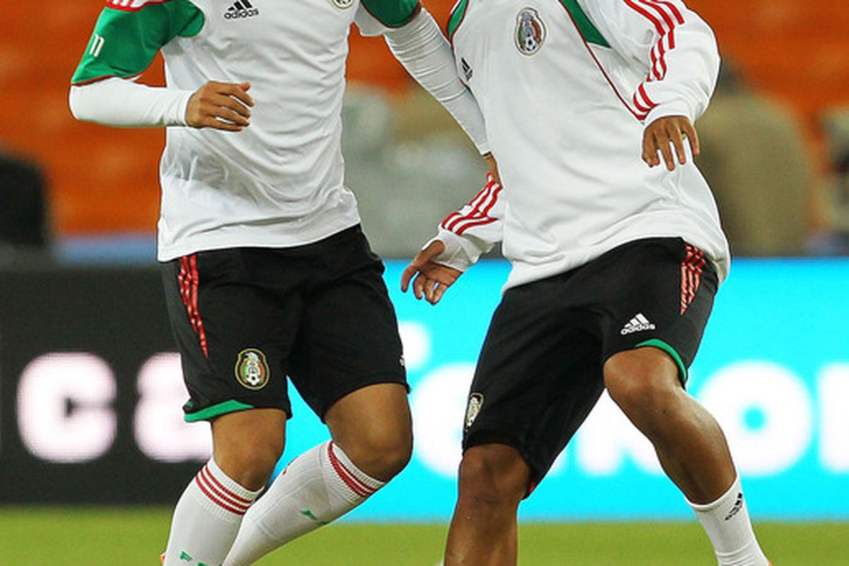 Carlos Vela challenges Giovani Dos Santos of Mexico during a Mexico training session ahead of the 2010 FIFA World Cup (Photo by Clive Rose/Getty Images)