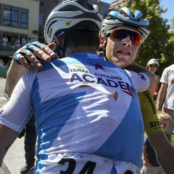 Ben Hermans is congratulated by teammate Nathan Earle, 34, after finishing Stage 6 of the Tour of Utah on Main Street in Park City on Sunday, Aug. 18, 2019. Hermans won the general classification standings with a 50-second lead.