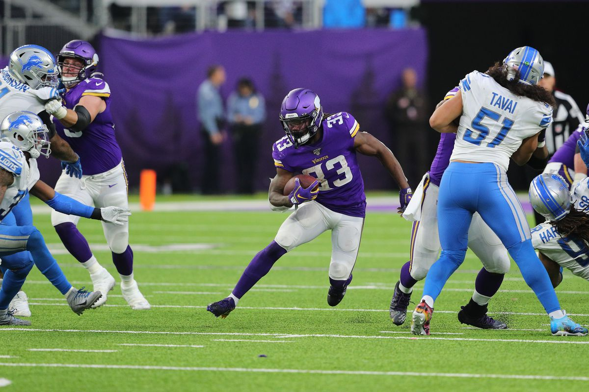 Dalvin Cook of the Minnesota Vikings carries the ball for a first down against the Detroit Lions in the fourth quarter at U.S. Bank Stadium on December 8, 2019 in Minneapolis, Minnesota.