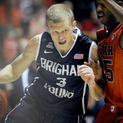 Brigham Young Cougars guard Tyler Haws (3) drives to the basket as Utah Utes guard Delon Wright (55) defends during a game at the Jon M. Huntsman Center on Saturday, December 14, 2013.