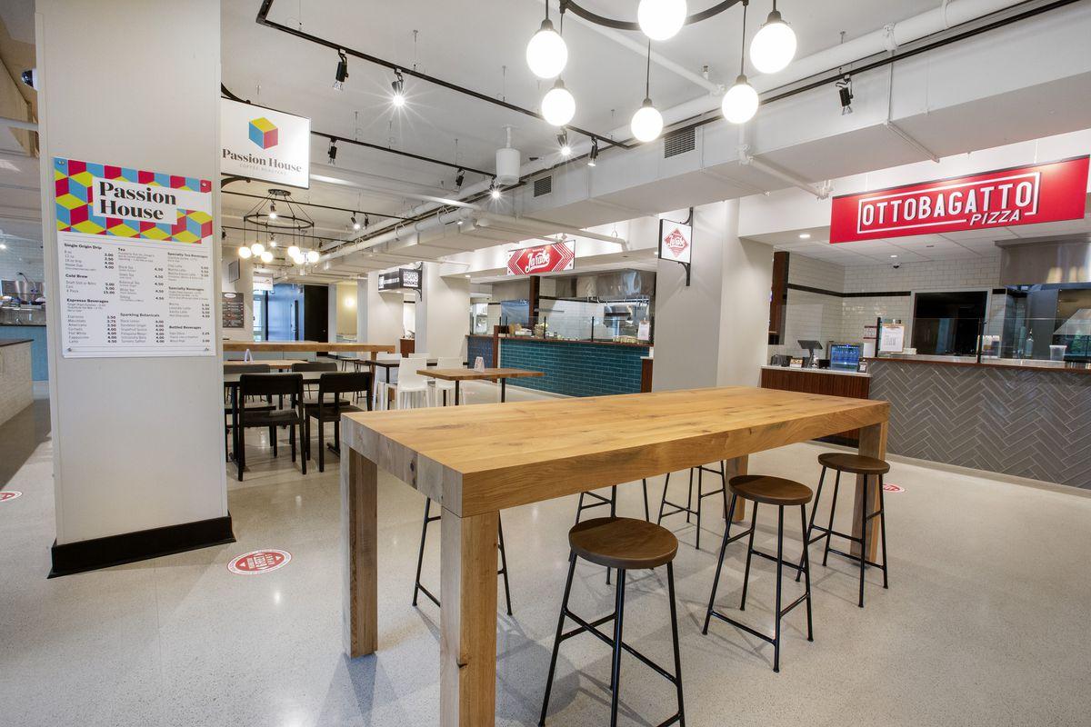 A shiny white interior of a food hall