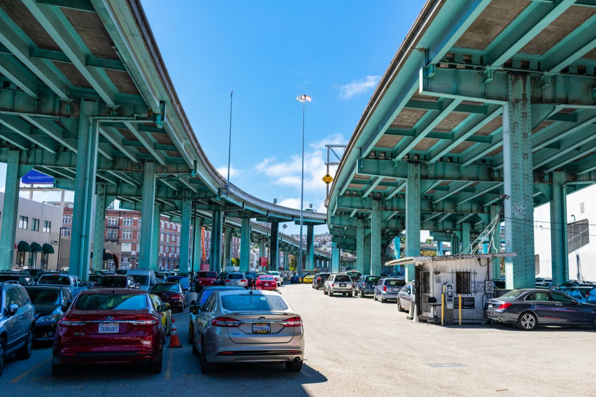 Cars parked beneath two freeway overpasses in San Francisco.