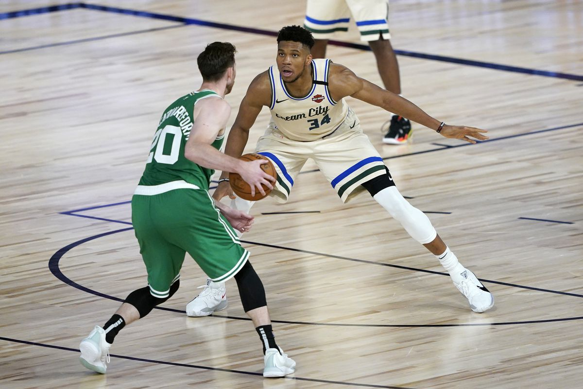 Gordon Hayward of the Boston Celtics looks to pass as Giannis Antetokounmpo of the Milwaukee Bucks defends during the second half of an NBA basketball game Friday, July 31, 2020, in Lake Buena Vista, Florida.