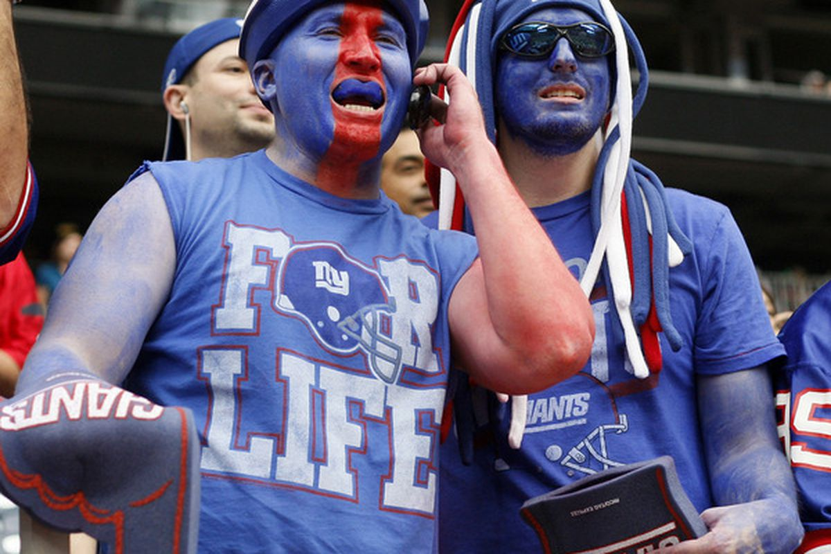 Giants fans invaded Reliant Stadium Sunday and proudly showed off their true colors. (Photo by Bob Levey/Getty Images)
