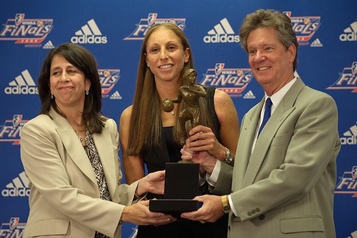 Diana Taurasi receives the 2009 WNBA MVP award from league president Donna Orender and a representative of corporate sponsor Kia Motors. Photo by Max Simbron