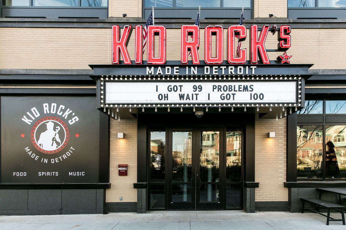 """Neon signage on the exterior of Kid Rock's Made in Detroit restaurant with a marquee reading """"I've got 99 problems. Oh wait I've got 100."""""""