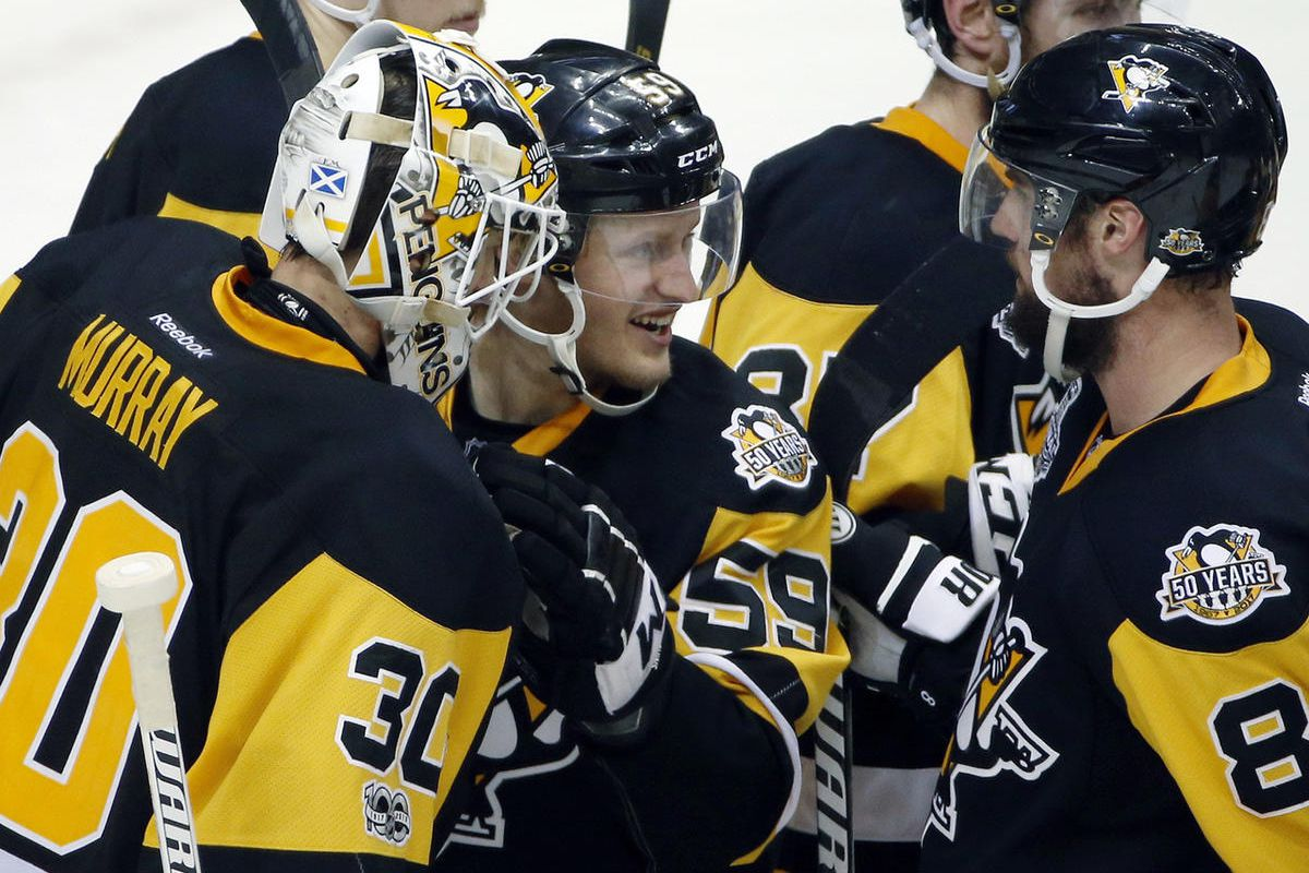Pittsburgh Penguins' Matt Murray, left, Jake Guentzel, center, and Brian Dumoulin celebrate after the Penguins defeated the Nashville Predators 4-1 in Game 2 of the NHL hockey Stanley Cup Final, Wednesday, May 31, 2017, in Pittsburgh. (AP Photo/Gene J. Pu