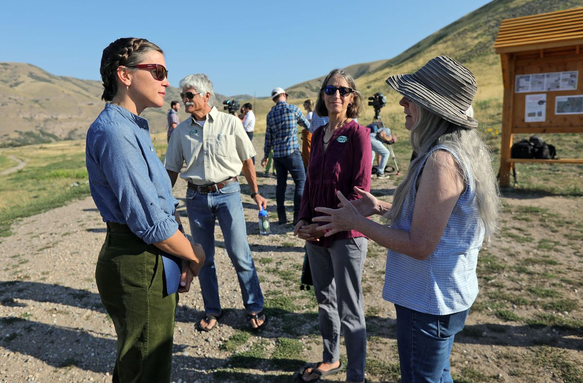 Salt Lake City Mayor Erin Mendenhall, left, talks with Save Our Canyons campaign members Dan Schelling, Hilary Jacobs and Debbie Feder after discussing the city's plans to review the Foothills Trail System and pause building trails during a press conference at the Bonneville Shoreline Access trailhead in Salt Lake City on Tuesday. The Save Our Canyons campaign members thanked the mayor for paying attention and being inclusive.