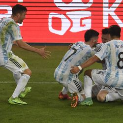 Players ran to Messi at the final whistle