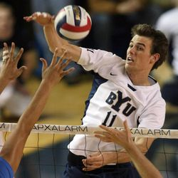 BYU's Russell Holmes (11) hits between a UCLA block as BYU faces UCLA in men's volleyball action at the Smith Field House in Provo Saturday, January 13, 2007. Holmes, who served a mission in England, is part of USA's men's volleyball team.