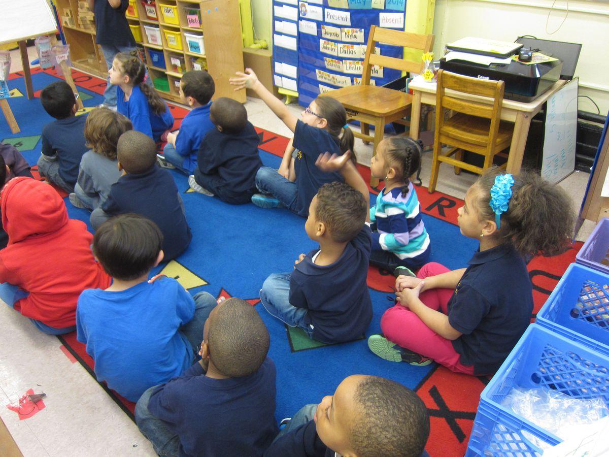 Pre-K students at P.S. 63-S.T.A.R. Academy during a literacy lesson.