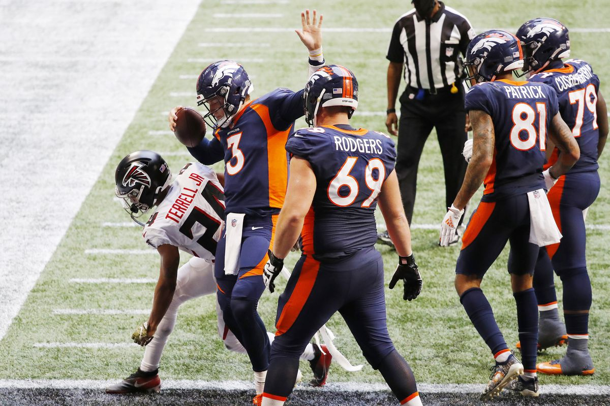 Drew Lock #3 of the Denver Broncos reacts after rushing for a touchdown during the fourth quarter against the Atlanta Falcons at Mercedes-Benz Stadium on November 08, 2020 in Atlanta, Georgia.