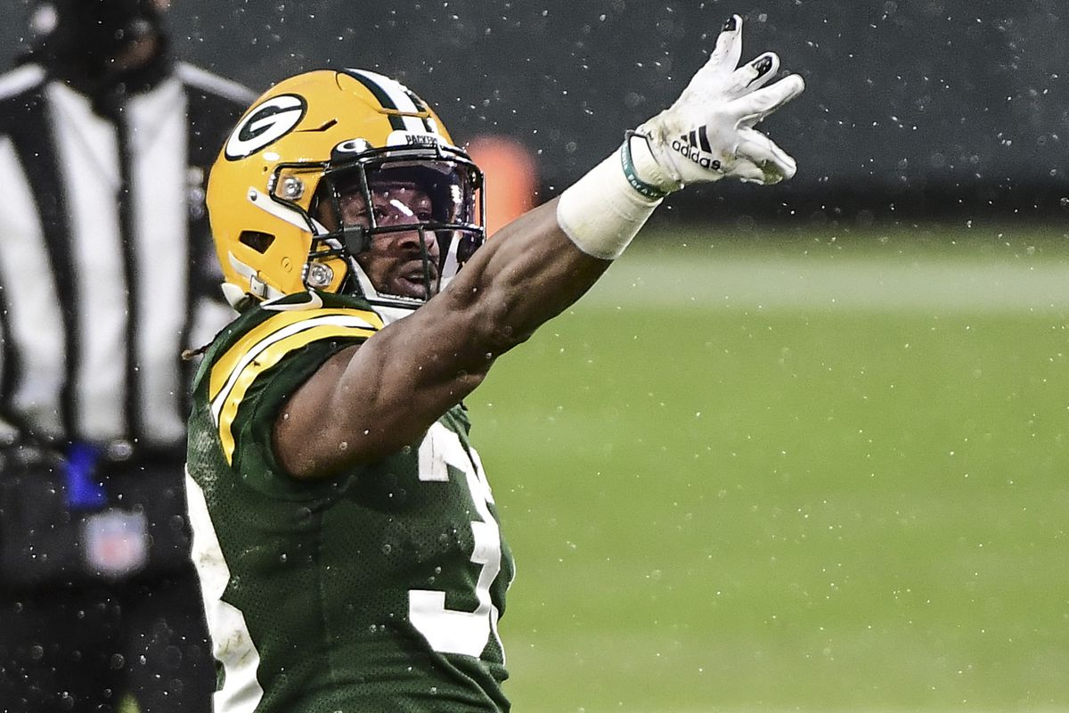 Green Bay Packers running back Aaron Jones (33) reacts after a first down in the second quarter during the game against the Los Angeles Rams at Lambeau Field.