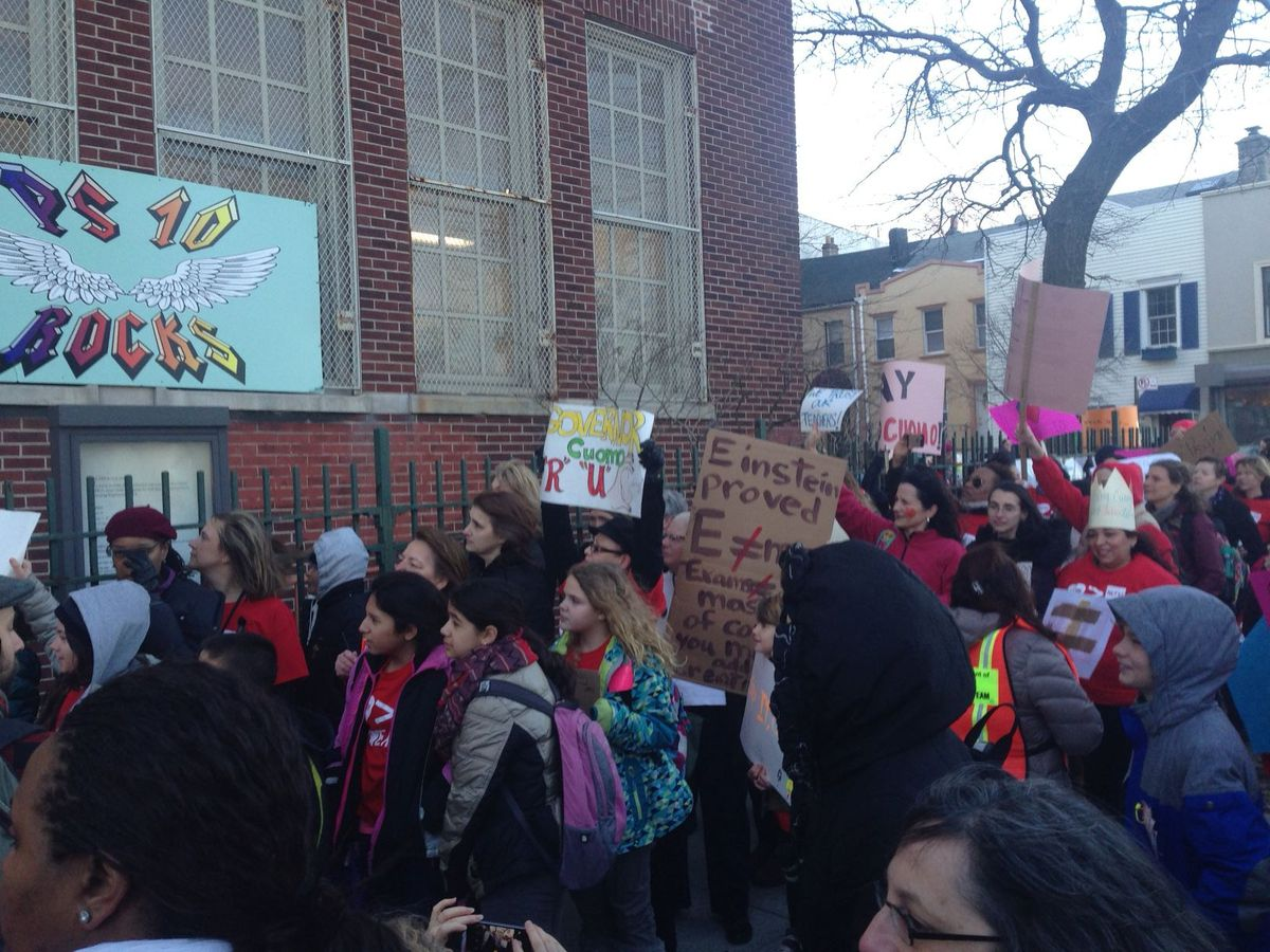 Students and parents rally outside of District 15's P.S. 10 in Brooklyn.