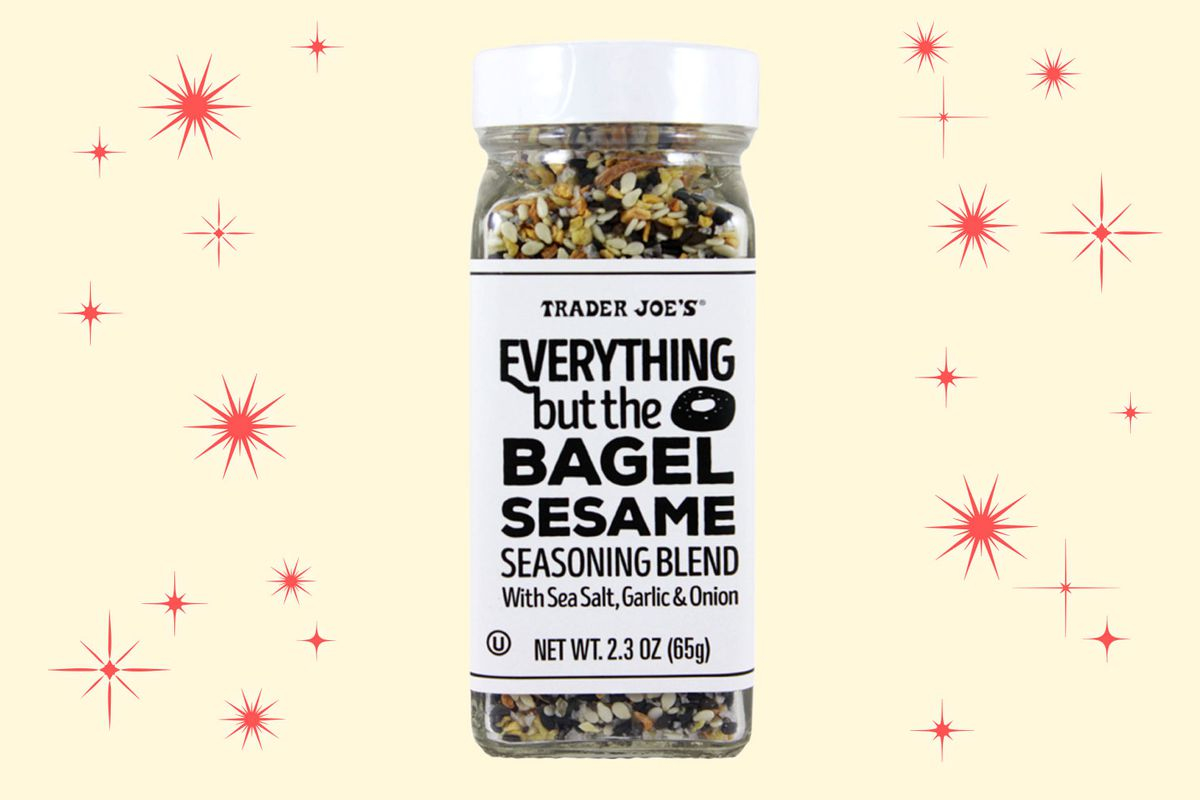 A jar of Everything But the Bagel Seasoning Blend on a tan background with red stars.
