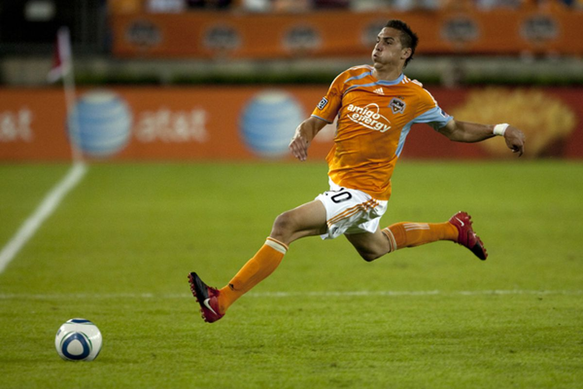 HOUSTON - APRIL 10:  Geoff Cameron #20 of the Houston Dynamo hustles to save the ball from going out of bounds against the Los Angeles Galaxy at Robertson Stadium on April 10, 2010 in Houston, Texas.  (Photo by Bob Levey/Getty Images)