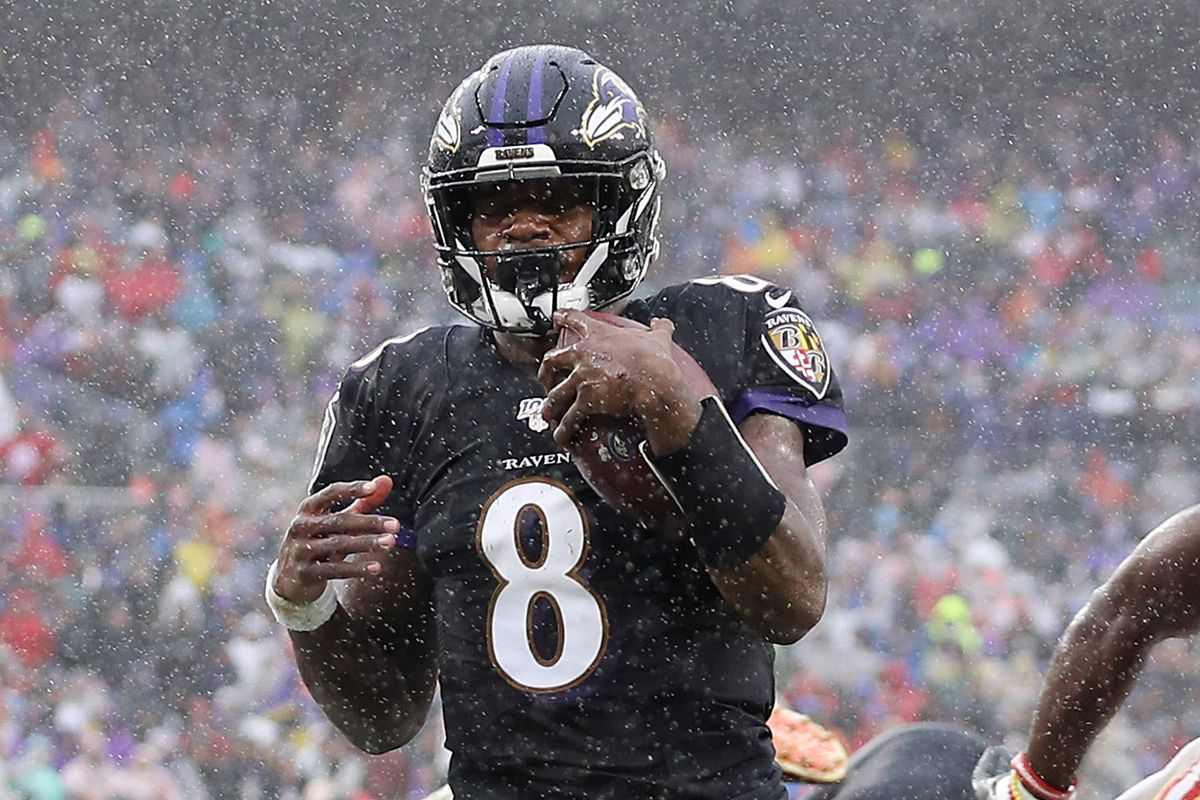Lamar Jackson of the Baltimore Ravens rushes for a 1-yard touchdown during the second quarter against the San Francisco 49ers at M&T Bank Stadium on December 01, 2019 in Baltimore, Maryland.