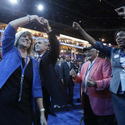 North Carolina Lt. Gov. Walter Dalton, second from left, dances with his wife Lucille on the floor as Singer James Taylor performs at the Democratic National Convention in Charlotte, N.C., on Thursday, Sept. 6, 2012.