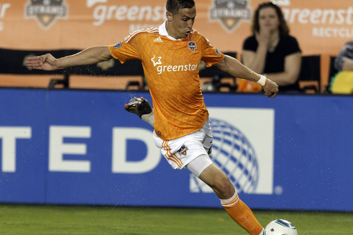 HOUSTON - MARCH 19:  Geoff Cameron #20 of the Houston Dynamo puts the ball on goal against the Philadelphia Union in the second half at Robertson Stadium on March 19, 2011 in Houston, Texas.  (Photo by Bob Levey/Getty Images)