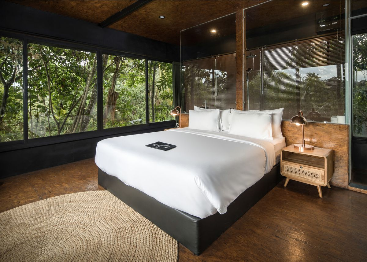 Modern furniture in hotel room lofted in the trees.