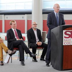 Layton Construction Director of Corporate Marketing Alan D. Rindlisbacher speaks during a press conference at the Salt Palace Convention Center in Salt Lake City, as officials announce Monday, Aug. 24, 2015, that the Outdoor Retailer Summer and Winter markets have been extended through 2018.