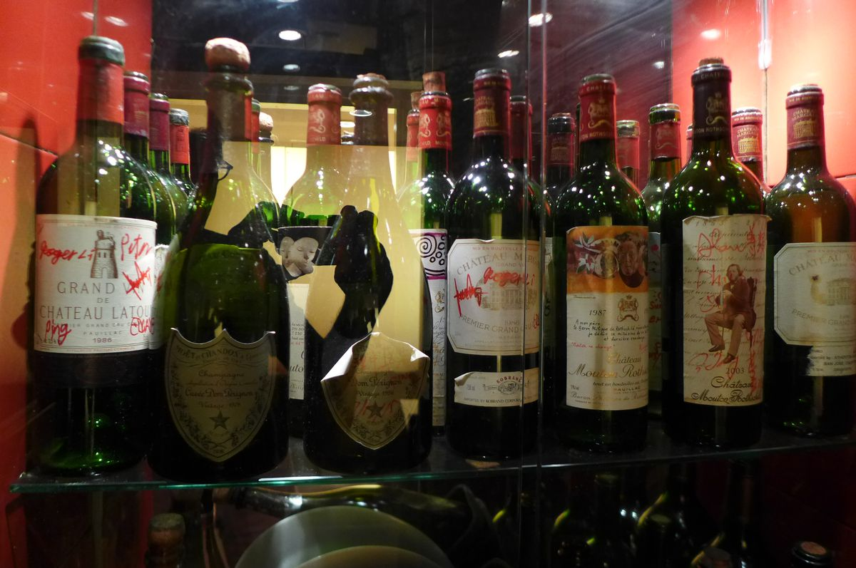 Cabinets filled with bottles signal the wine friendliness.