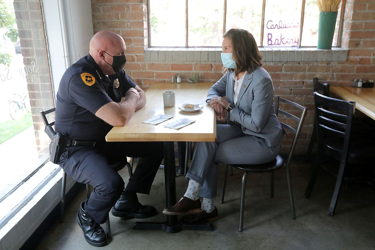 Salt Lake Police Chief Mike Brown, left, and Mayor Erin Mendenhall talk at Carlucci's Bakery about the city's crime rates.