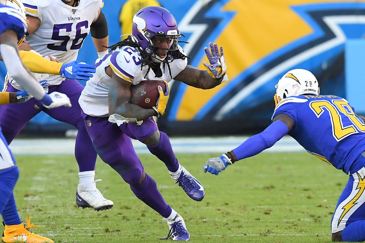 Running back Mike Boone of the Minnesota Vikings runs for a first down in the second half of the game against the Los Angeles Chargers at Dignity Health Sports Park on December 15, 2019 in Carson, California.
