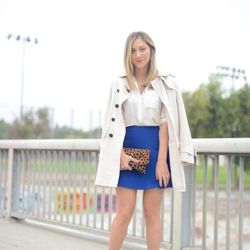 """Emily of <a href=""""http://cupcakesandcashmere.com""""target=""""_blank"""">Cupcakes and Cashmere</a> is wearing a Coach trench coat, a <a href=""""http://www.clubmonaco.com/product/index.jsp?productId=21225766&cp=12243590.12266442.12454409&ab=ln_women_apparel_shirts&"""