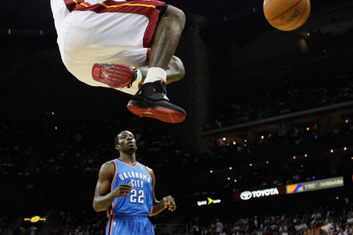 KANSAS CITY, MO - OCTOBER 08:  LeBron James #6 of the Miami Heat dunks over Jeff Green #22 of the Oklahoma City Thunder during the preseason game on October 8, 2010 at the Sprint Center in Kansas City, Missouri.  (Photo by Jamie Squire/Getty Images)