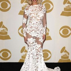 """""""Beyonce wore an exceptional custom Michael Costello gown with embroidered and sheer details. I loved the winter white mixed with a little floral, a really interesting combination. I didn't love the lipstick color, it kind of reminded me of The Joker, but"""