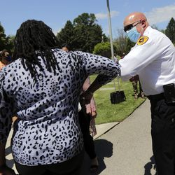Darlene McDonald, left, gives an elbow bump to Salt Lake City Police Chief Mike Brown after a press conference to announce the Salt Lake City Commission on Racial Equity in Policing at the International Peace Gardens in Salt Lake City on Thursday, June 25, 2020. McDonald will serve on the commission.