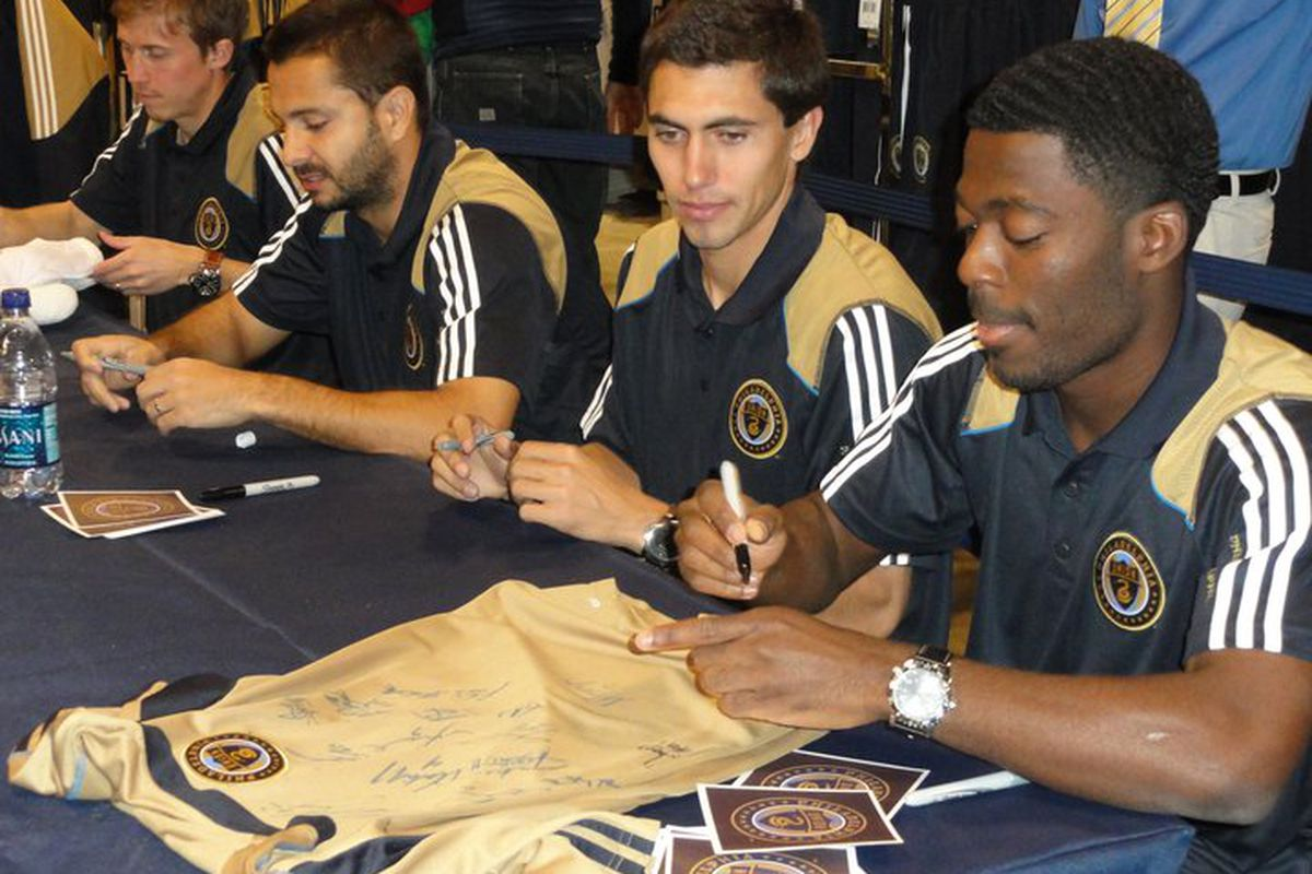 Members of the Union sign autographs for fans at the Meet the Players event. These were the 4 players that came down into the team store. (Photo by Joseph Samuel)