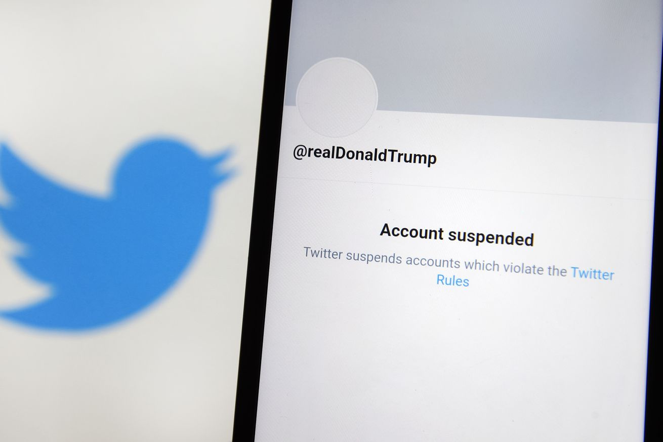 In this photo illustration, an 'Account suspended' message...
