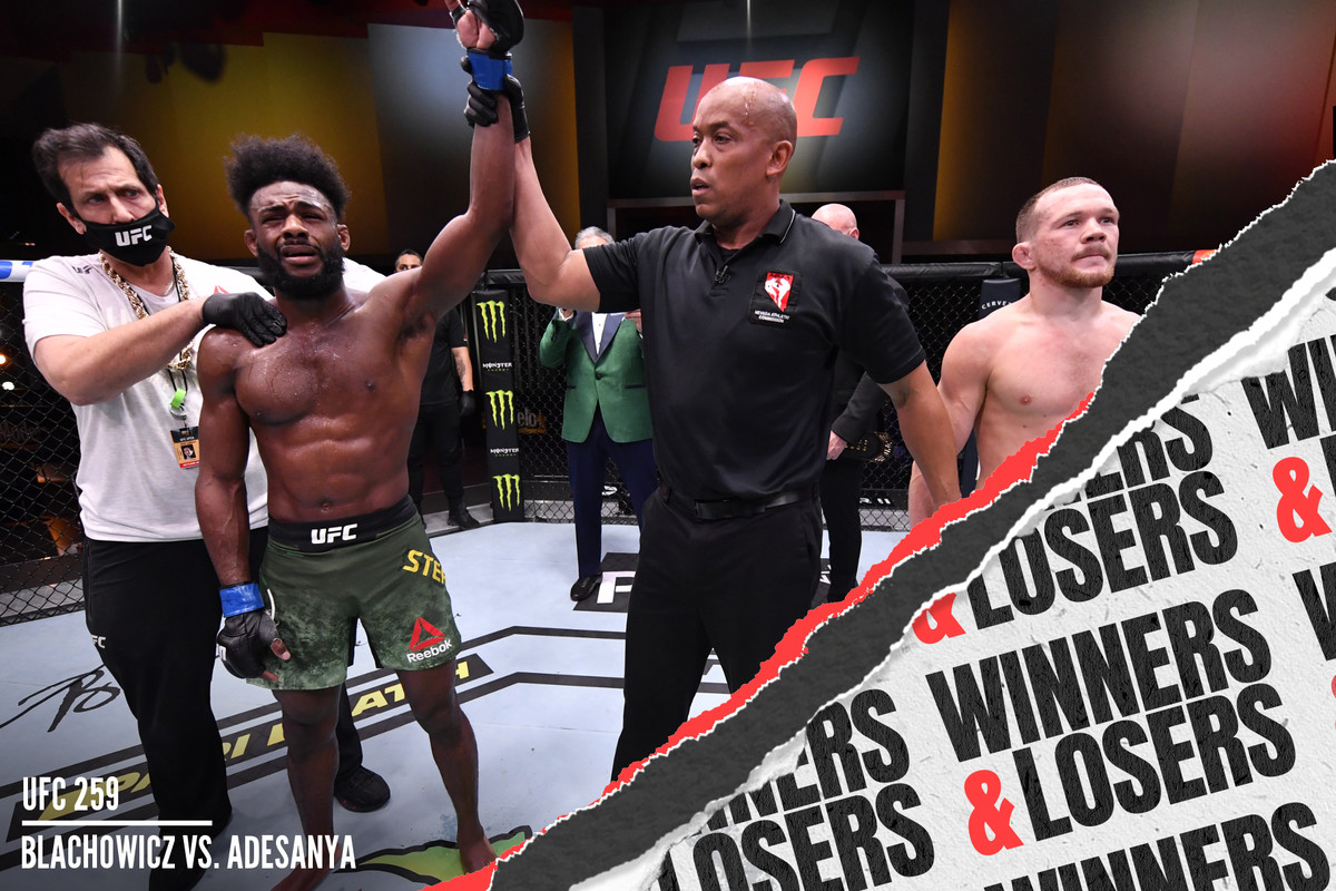 Aljamain Sterling reacts after his victory by disqualification over Petr Yan of Russia due to an intentional foul in their bantamweight championship fight at UFC 259.