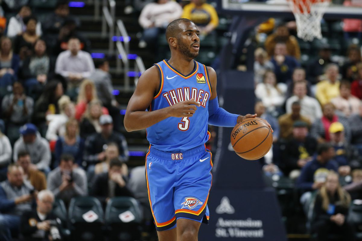 Oklahoma City Thunder guard Chris Paul brings the ball up court against the Indiana Pacers during the first quarter at Bankers Life Fieldhouse.