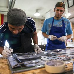 """Venustiano Gregorio, left, and Preston Powell, right, work on """"The Roots of Knowledge,"""" a 200-foot-long stained glass installation for Utah Valley University, at Holdman Studios in Lehi on Friday, Nov. 4, 2016. The university announced a $1.5 million donation from philanthropists Marc and Deborah Bingham that will enable the completion of the massive stained glass installation."""