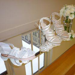 On left: Lila vachette flat sandal ($295); On right: Paige vachetta with mesh criss cross stiletto ($550)