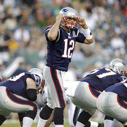 New England Patriots quarterback Tom Brady calls a play in the first quarter of an NFL preseason football game against the Philadelphia Eagles.