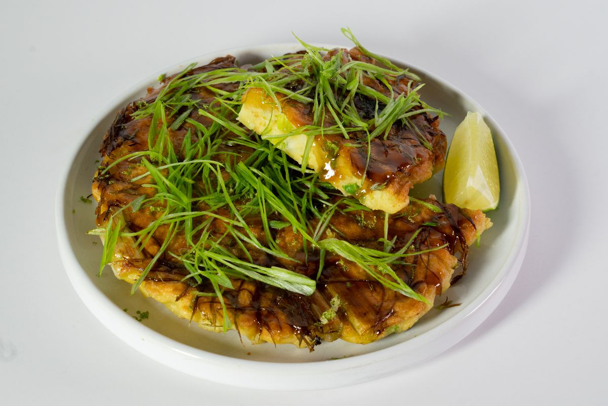 A round savory Japanese pancake topped with green onion