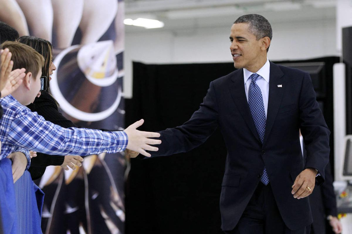 President Barack Obama reaches to greet guest as the Rolls-Royce Crosspointe jet engine disc manufacturing facility, Friday, March, 9, 2012, in Prince George, Va.