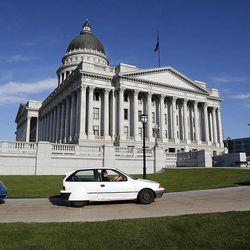 Electric vehicles drive away from the Capitol following a press briefing concerning alternative fuel vehicle strategies in Salt Lake City, Wednesday, Aug. 7, 2013.