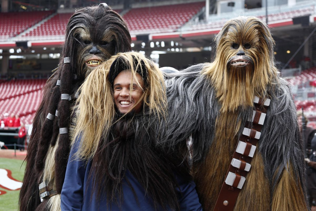 Carlos Gomez posing for a picture with two Ewoks.