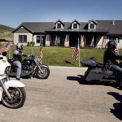 Patriot Guard Riders escort veteran U.S. Army Sgt. 1st Class Travis Vendela and his family to the unveiling of their new home in Huntsville, Weber County, on Friday, July 3, 2020.