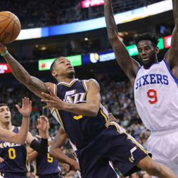 Utah Jazz guard Trey Burke (3) is fouled by Philadelphia 76ers forward JaKarr Sampson (9) on a drive to the basket as the Jazz and the 76ers play Saturday, Dec. 27, 2014, at EnergySolutions arena in Salt Lake City.