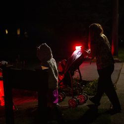 """Crissy Norton walks with her three daughters to go use the kitchen to heat up dinner at Lake Washington United Methodist Church in Kirkland, Wash., on Saturday, Oct. 12, 2019. Norton, her husband Matthew Branstetter and three children have been using the Safe Parking program for the past several months, first becoming homeless in December 2018.The family is on a wait list for transitional housing and is hoping to hear back about an apartment soon. """"It's the only thing getting me through this week,"""" said Norton. """"We need this transitional housing more than anything."""""""