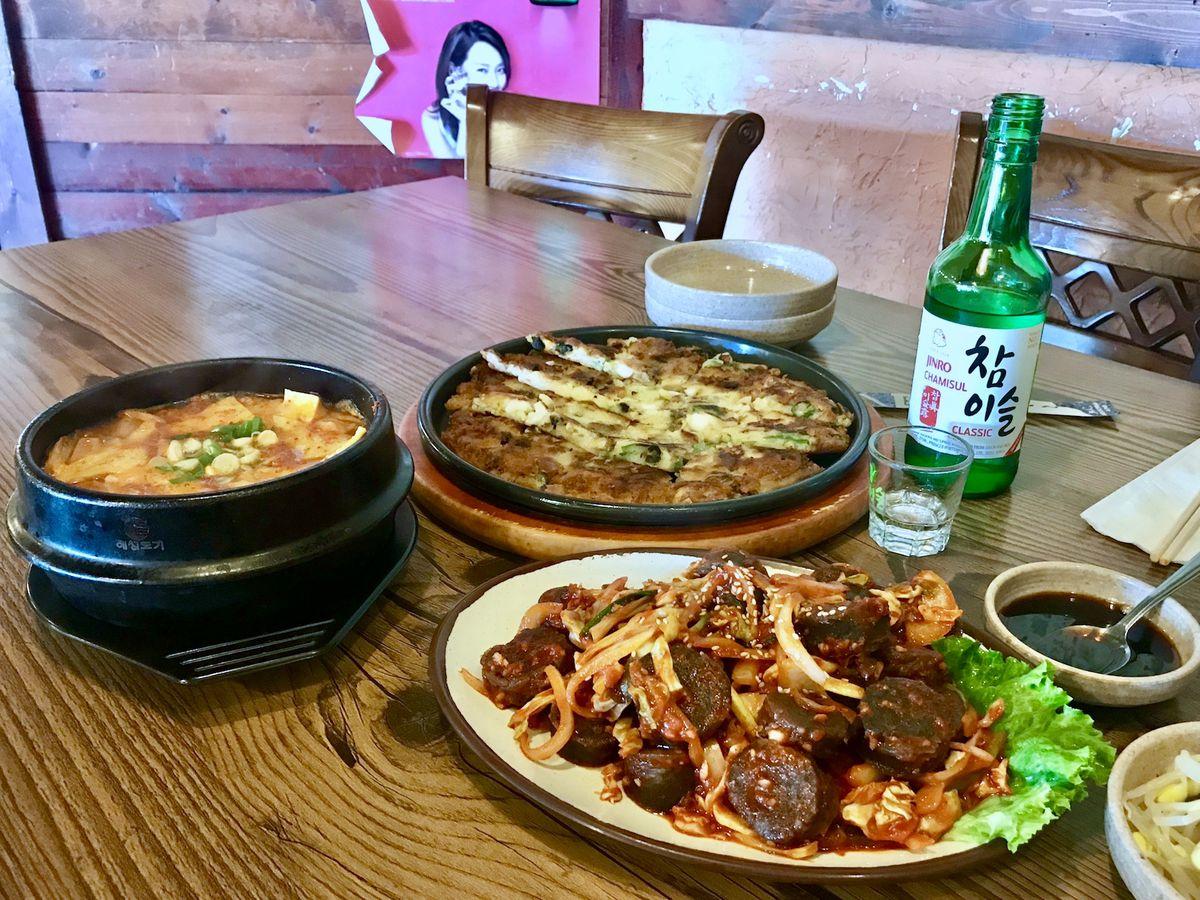 Table full of Korean food and shoju