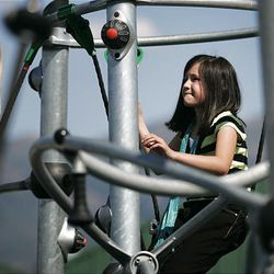 The playground targets 14-to-17-year-olds, but Paige Reeder, left, and Ashlee Gonzales, both 9, enjoy it, too.