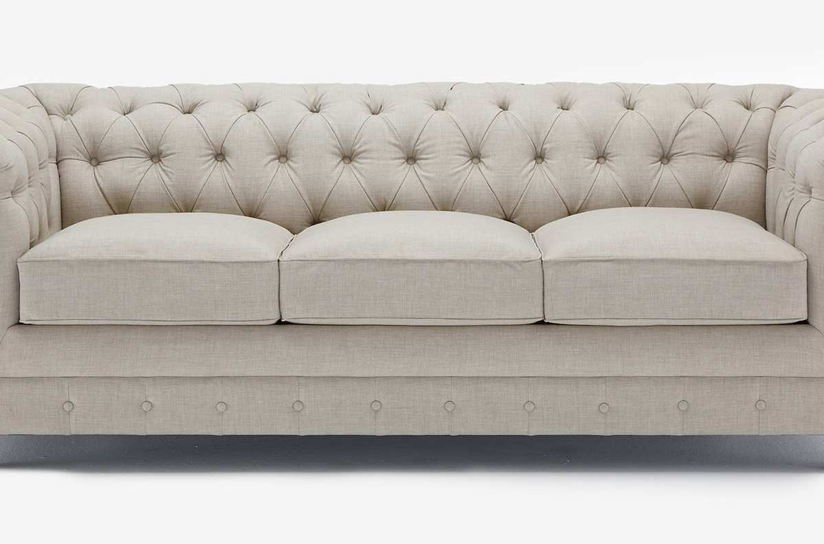 Beige tufted sofa.
